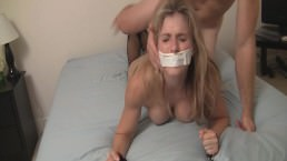 Bound, gagged, and fucked bondage slut in a leather skirt