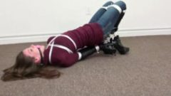 Hottie hogtied and gagged wearing a sweater