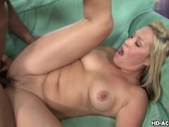 Busty blonde chick gobbling black dick