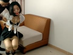 Chinese slave in rope bondage and ballgagged