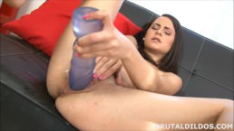 Brunette fucking her pussy with a big purple brutal dildo in HD