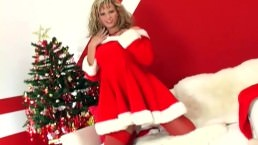 Busty babe Zuzana doing a holiday tease in red stockings and boots